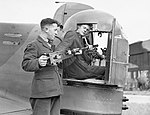 Armourers install .303 Browning machine guns into the rear turret an Armstrong Whitley Mk V of No. 58 Squadron RAF at Linton-on-Ouse, Yorkshire, June 1940. CH246.jpg