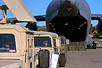 Army Spc. James Williams awaits the go-ahead for Humvees to be backed into a C-17 Globemaster III (32912720506).jpg