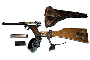 "Machine pistol - Long barrelled Luger P08 (nicknamed the ""Artillery Pistol""), with a 32-round drum magazine and a detachable stock"