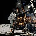 Astronaut Alan L. Bean is about to step off the ladder of the Lunar Module.jpg