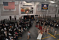 Attendees gather for the U.S. Navy chief petty officer (CPO) pinning ceremony inside the USS Midway Ceremonial Drill Hall at Recruit Training Command at Naval Station Great Lakes, Ill., Sept 120914-N-IK959-860.jpg