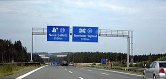 DIN 1451 - German road sign using both the DIN 1451 Mittelschrift (left) and Engschrift (right) typefaces