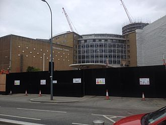 Television Centre, London - Television Centre during redevelopment in May 2015. The BBC blocks on the wall of TC1 were removed in September 2014.