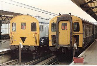 British Rail Class 205 - BR Class 205 3H DEMU no. 1127 with Class 421 3 4-CIG EMU no. 7303, Portsmouth Harbour, 30 October 1985 under British Rail.