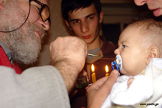 Confirmation - Chrismation of a newly baptized infant at a Georgian Orthodox church.