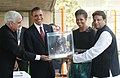 Barack Obama and the First Lady Mrs. Michelle Obama being presented a bust of Mahatma Gandhi by the Minister of State (Independent Charge) for Corporate Affairs and Minority Affairs, Shri Salman Khurshid.jpg