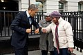 Barack Obama bumps elbows with women in the street.jpg