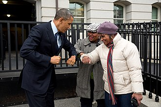 Elbow bump - Barack Obama bumping elbows with two General Services Administration workers in 2012