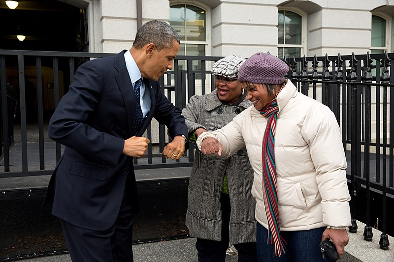 File:Barack Obama bumps elbows with women in the street.jpg