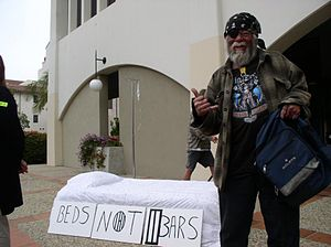 "Homeless Bill of Rights - The ""Beds Not Bars"" slogan suggests that society must help homeless people instead of outlawing their behavior."