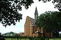 Besko, nový kostel se stromy.jpg