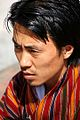 Bhutanese young man in traditional dress - Flickr - babasteve.jpg