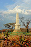 About twelve km from Estcourt along the main road to Colenso, opposite Chieveley railway station, a farm road turns off to the north and after crossing the railway line and the Bloukrans River, reaches the Bloukrans Monument. The Voortrekkers who suffered most during the night of Friday, 16 February, were those whose laagers stood at the Moordspruit and the Bloukrans River. The first to be attacked were the laagers of the Liebenbergs, the Rossouws and the Bezuidenhouts; next Type of site: Memorial Previous use: battlefield (on). Current use: memorial. From N3 take Colenso Ladysmith turn-off and head for Colenso. After about 7 km (4 mi) turn right and go abou. Scene of the 'Groot Moord' February 1838, of some 480 Voortrekkers and their servants by Zulu impi;