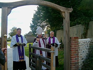 Lindsay Urwin - Urwin consecrating a new churchyard Tapsel gate in Sussex in 2004.
