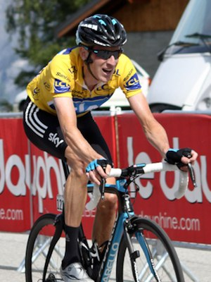 Bicycle performance - Bradley Wiggins in the yellow jersey, finishing the 2011 Critérium du Dauphiné.