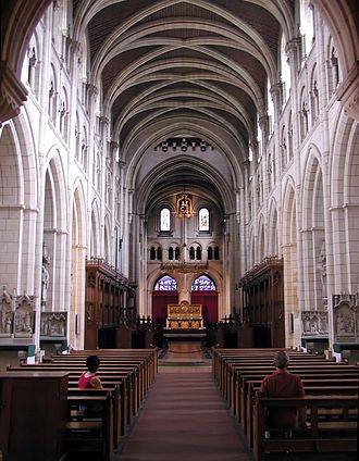 Buckfast Abbey - The nave of the Abbey church is in a mixture of Romanesque and Gothic styles