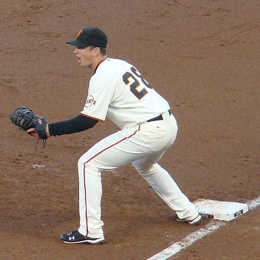 Buster Posey holding the runner at first