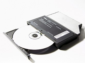 CD-ROM - A CD-ROM in the tray of a partially open DVD-ROM drive.