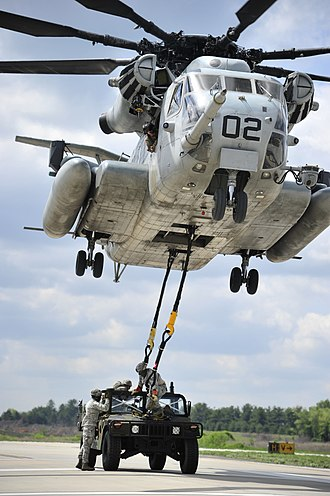 Joint Base McGuire–Dix–Lakehurst - A CH-53E Super Stallion slingloads a Humvee.