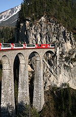 Rhaetian Railway Glacier Express on the Landwasser Viaduct entering the Landwasser tunnel.