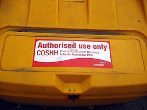 COSHH - A roadside bin with a COSHH notice