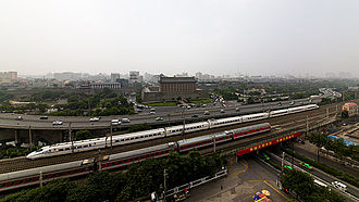 China Railway High-speed - A CRH2C, possibly a sleeper train, on the Longhai Railway outside of city walls of Xi'an.