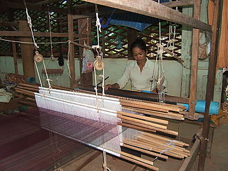 Cambodian art - Cambodian woman weaving silk near Siem Reap, 2007