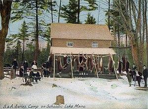 Deer hunting - A hunting camp with dressed deer at Schoodic Lake, Maine circa 1905.