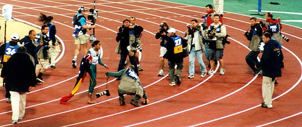 Cathy Freeman after the 400 metre final Cathy400 mediafrenzy.jpg