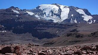 Cerro El Plomo - The glaciated south-west face, visible from Santiago, with Cerro Leonera to the left
