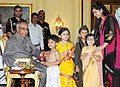 Children tying 'Rakhi' to the President, Shri Pranab Mukherjee, on the occasion of 'Raksha Bandhan', in New Delhi on August 02, 2012.jpg