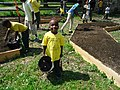 Children volunteers helping plant a pollinator garden.jpg
