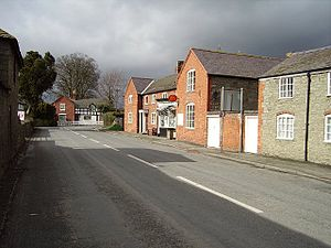 Chirbury - The centre of the village with its post office. The road here is the A490 and B4386 combined.