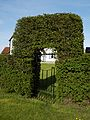 Church of St Mary Little Laver Essex England - churchyard hedge arch and gate at east.jpg