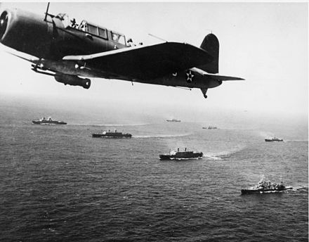"A SB2U Vindicator scout bomber from USS Ranger flies anti-submarine patrol over Convoy WS-12, en route to Cape Town, November 27, 1941. The convoy was one of many escorted by the US Navy on ""Neutrality Patrol"", before the US officially entered the war. Convoy WS-12 en route to Cape Town, 1941.jpg"