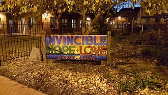 "Camden, New Jersey - A community sign near Camden's Cooper Grant neighborhood showcasing the cities official tagline ""A City Invincible"""
