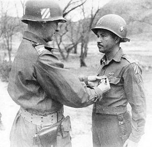 Juan César Cordero Dávila - General Cordero pins the Silver Star on Cpl. Enrique Vega Lugo