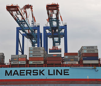 Intermodal freight transport - Containers being transferred to a cargo ship at the container terminal of Bremerhaven.