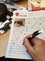Crossword solving using ballpoint pen.jpg