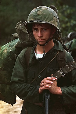 Da Nang, Vietnam. A young Marine private waits on the beach during the Marine landing. - NARA - 532432 (restored).jpg