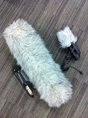 "Boom operator (media) - ""Dead wombat"" (L) and  ""dead kitten"" (R) wind-attenuating microphone covers"