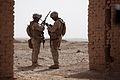 Defense.gov News Photo 100714-M-0301S-049 - U.S. Marines with Bravo Company 3rd Low Altitude Air Defense Battalion check their radios while conducting a shura for Afghan civilians in.jpg