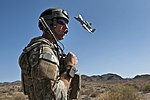 Defense.gov News Photo 110923-F-MQ656-036 - Joint Terminal Attack Controller Tech. Sgt. Aaron Switzer U.S. Air Force uses a radio to communicate with pilots of A-10 Thunderbolt II aircraft.jpg