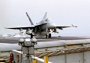 CBU-100 Cluster Bomb - A US naval F/A-18C Hornet launches from USS Nimitz to a mission in Southern Iraq. Among other weapons, the plane carries CBU-100 Rockeye cluster bombs