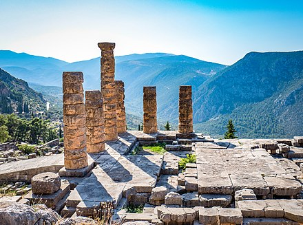 Ruins of the ancient temple of Apollo at Delphi, overlooking the valley of Phocis. Delphi Temple of Apollo.jpg