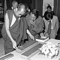 Detail, Tenzin Gyatso, 14th Dalai Lama in 1979 (center) with Lobsang Phuntshok Lhalungpa (next to Kundun) looking at Tibetan books or Pecha at the Library of Congress on 11 September 1979, from- Dalai Lama visits LOC (cropped) (cropped).jpg
