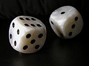 Two standard six-sided pipped dice with rounded corners.