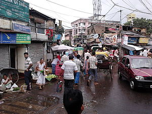 Sealdah–Ranaghat line - The busy market area near Dum Dum railway station.