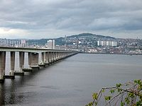 Dundee viewed across the Tay estuary from the southern side. The hill in the background is Dundee law which is situated approximately in the centre of the city. To the left is the Tay Road Bridge