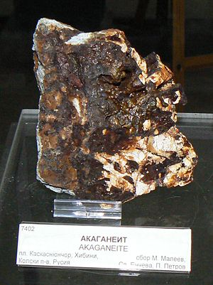 "Akaganéite - A piece of the mineral akaganeite. Exhibit of the ""Earth and Man"" Museum in Sofia, Bulgaria. Discovered in Kaskasnyunchorr, Khibiny Massif, Kola Peninsula, Russia"